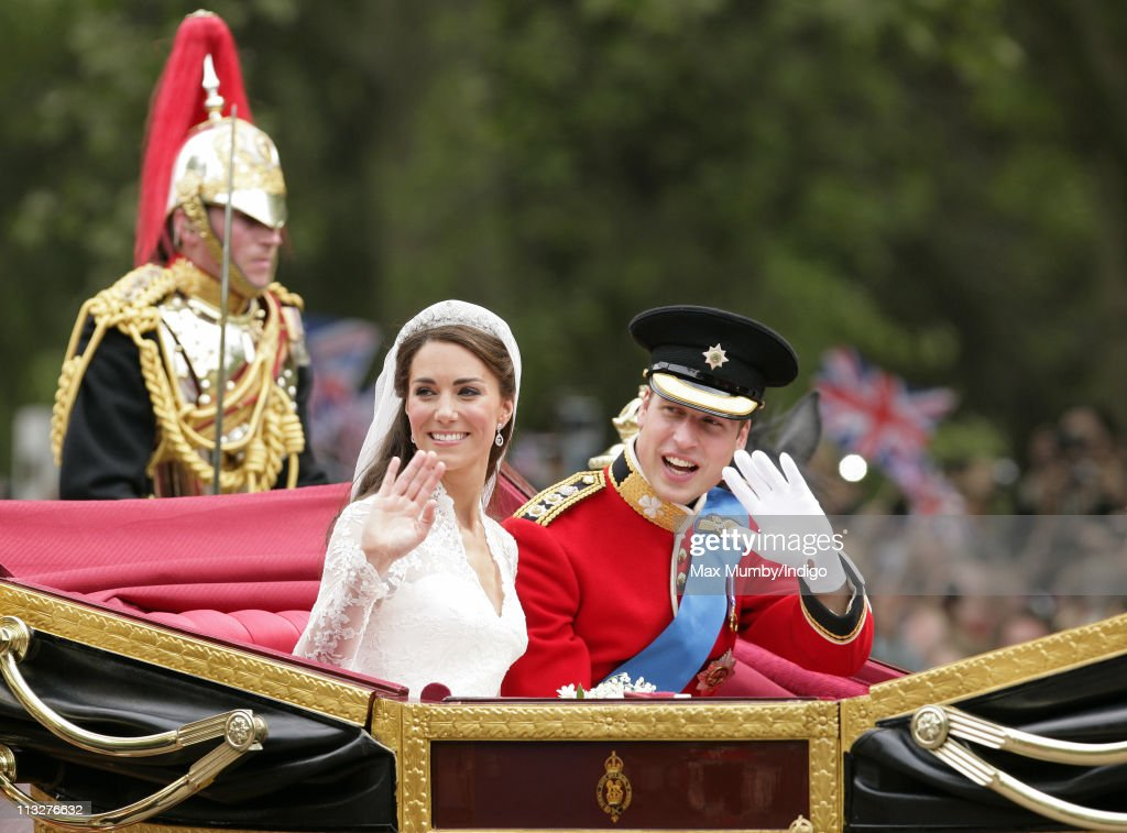 Catherine Duchess of Cambridge and Prince William Duke of Cambridge travel down The Mall on route to Buckingham Palace in a horse drawn carriage...