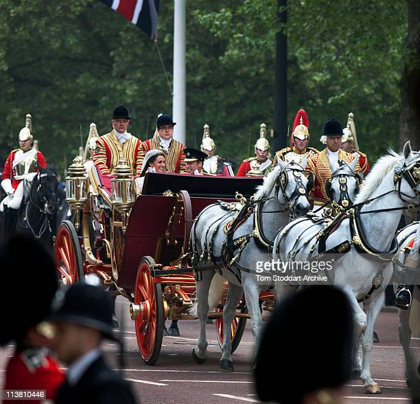 Catherine Duchess of Cambridge and Prince William Duke of Cambridge make the journey by carriage in procession to Buckingham Palace past crowds of...