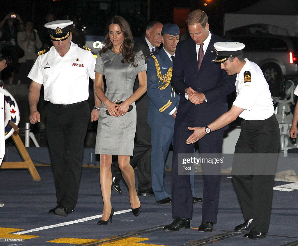 Catherine, Duchess of Cambridge and <a gi-track='captionPersonalityLinkClicked' href=/galleries/search?phrase=Prince+William&family=editorial&specificpeople=178205 ng-click='$event.stopPropagation()'>Prince William</a>, Duke of Cambridge are escorted by naval officers as they arrive on board HMCS Montreal on July 2, 2011 in Montreal Canada. The newly married Royal Couple are on the third day of their first joint overseas tour. The 12 day visit to North America will take in some of the more remote areas of the country such as Prince Edward Island, Yellowknife and Calgary. The Royal couple yesterday joined millions of Canadians in taking part in Canada Day celebrations which mark Canada's 144th Birthday.