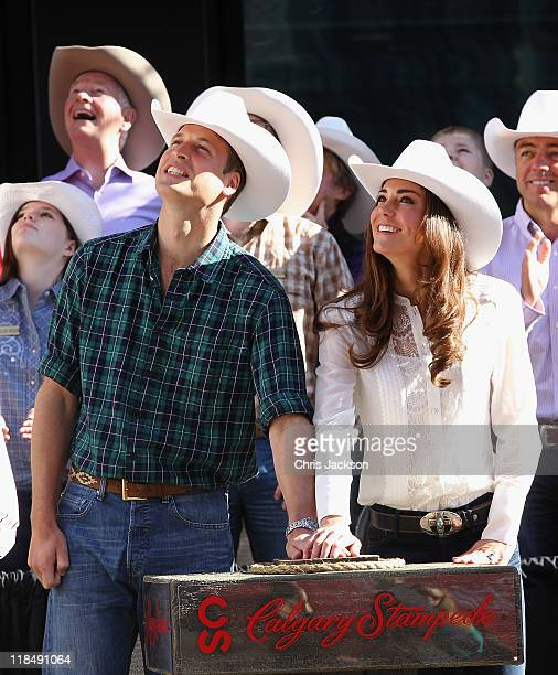 Catherine Duchess of Cambridge and Prince William Duke of Cambridge press the button to lauch the Calgary Stampede on July 8 2011 in Calgary Canada...