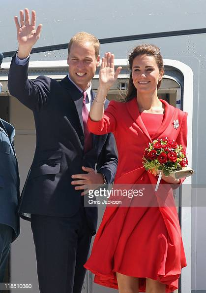 Catherine Duchess of Cambridge and Prince William Duke of Cambridge wave from the steps of the Royal plane as they leave from Calgary Airport to head...