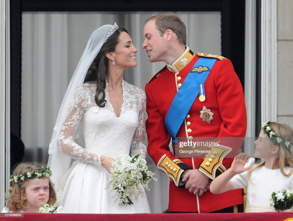 Catherine, Duchess of Cambridge and Prince William, Duke of Cambridge kiss on the balcony at Buckingham Palace on April 29, 2011 in London, England.