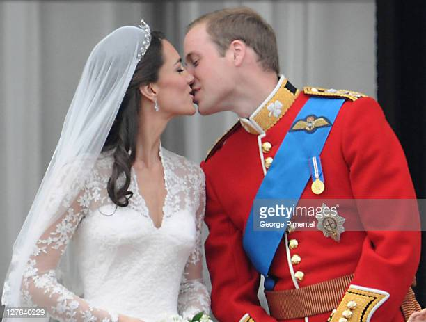 Catherine Duchess of Cambridge and Prince William Duke of Cambridge kiss on the balcony at Buckingham Palace on April 29 2011 in London England