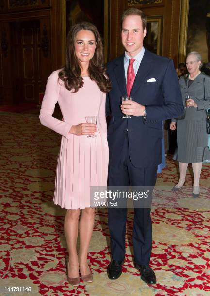 Catherine Duchess of Cambridge and Prince William Duke of Cambridge during a reception in the Waterloo Chamber before the Lunch For Sovereign...