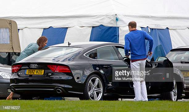 Catherine Duchess of Cambridge and Prince William Duke of Cambridge get into Prince William's new Audi A7 car after Prince William and Prince Harry...