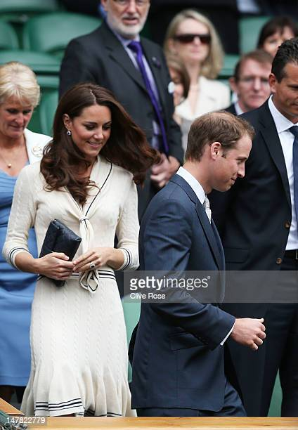Catherine Duchess of Cambridge and Prince William Duke of Cambridge make their way to their seats in the Royal Box on Centre Court during day nine of...