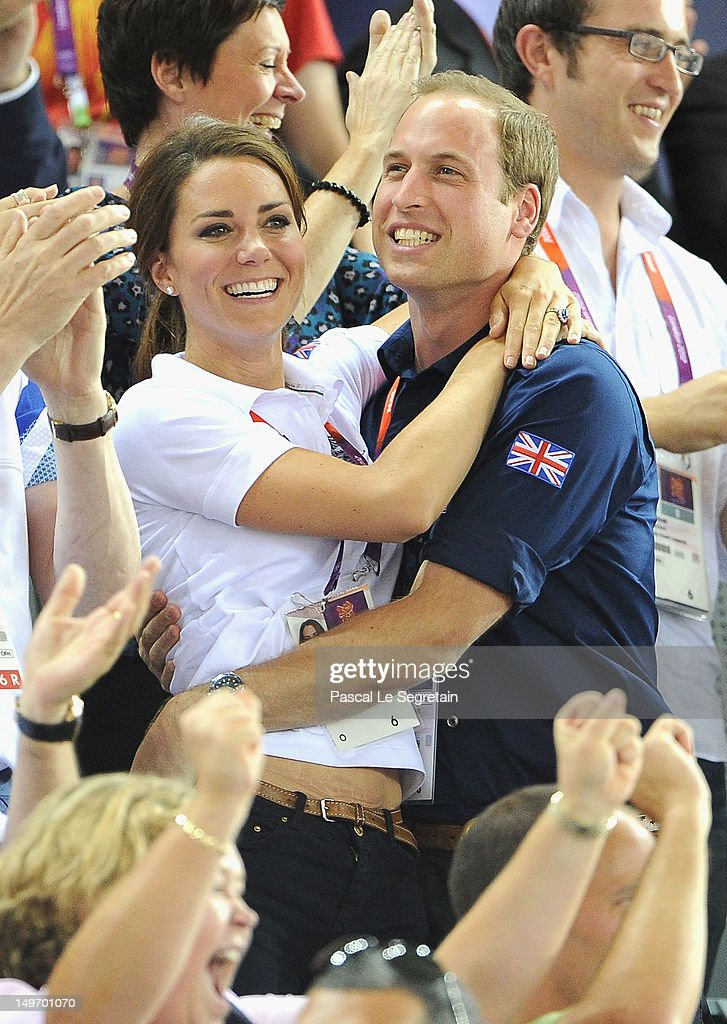 Catherine, Duchess of Cambridge and <a gi-track='captionPersonalityLinkClicked' href=/galleries/search?phrase=Prince+William&family=editorial&specificpeople=178205 ng-click='$event.stopPropagation()'>Prince William</a>, Duke of Cambridge embrace after Philip Hindes, Jason Kenny and Sir Chris Hoy of Great Britain win the gold and a new world record in the Men's Team Sprint Track Cycling final during Day 6 of the London 2012 Olympic Games at Velodrome on August 2, 2012 in London, England.