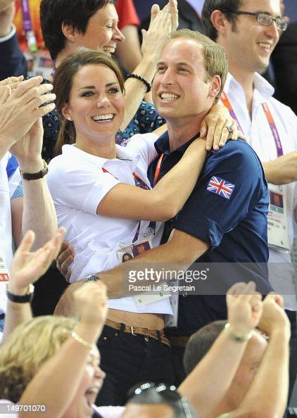Catherine Duchess of Cambridge and Prince William Duke of Cambridge embrace after Philip Hindes Jason Kenny and Sir Chris Hoy of Great Britain win...