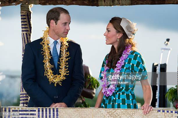 Catherine Duchess of Cambridge and Prince William Duke of Cambridge ride an opentop vehicle shaped like a traditional canoe at Honiara International...
