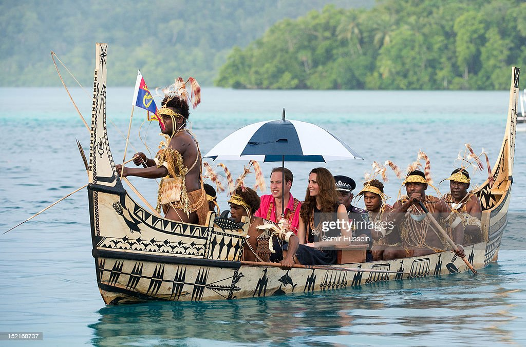 Catherine, Duchess of Cambridge and Prince William, Duke of Cambridge travel in a traditional canoe to Tuvanipupu Island on their Diamond Jubilee tour of the Far East on September 17, 2012 in Honiara, Guadalcanal Island. Prince William, Duke of Cambridge and Catherine, Duchess of Cambridge are on a Diamond Jubilee tour representing the Queen taking in Singapore, Malaysia, the Solomon Islands and Tuvalu.
