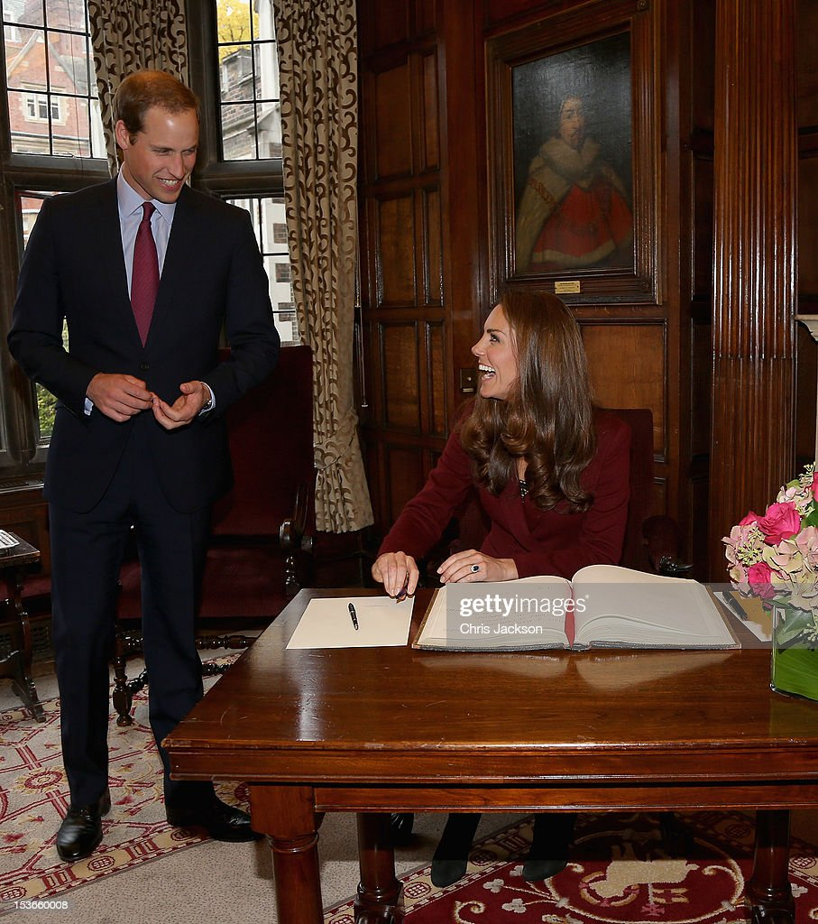 <a gi-track='captionPersonalityLinkClicked' href=/galleries/search?phrase=Catherine+-+Duchess+of+Cambridge&family=editorial&specificpeople=542588 ng-click='$event.stopPropagation()'>Catherine</a>, Duchess of Cambridge and Prince William, Duke of Cambridge laugh as they sign the visitors book as during a visit to Middle Temple on October 8, 2012 in London, England. The Duke of Cambridge, Master of the Bench, and The Duchess of Cambridge met recipients of the Queen Mother Scholarship, the Diana, Princess of Wales Scholarship and the Duke and Duchess of Cambridge Scholarships at Middle Temple Inn, London.