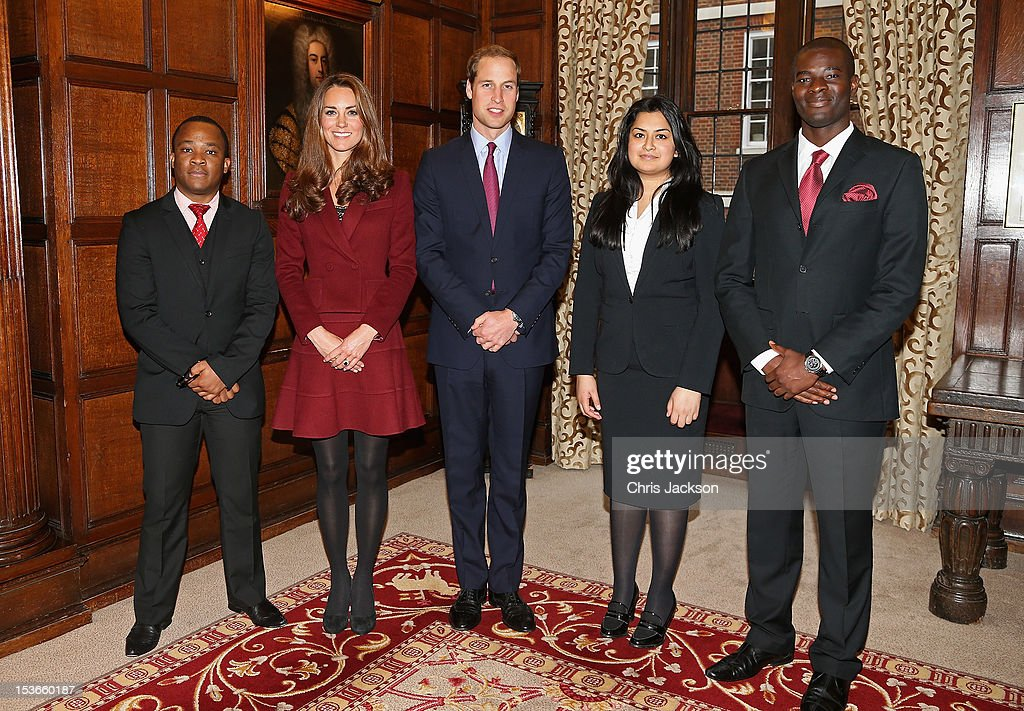 Catherine, Duchess of Cambridge and Prince William, Duke of Cambridge pose with (L-R) Lasts Year's Diana Scholarship winner Harry Azoh, this year's Princess Diana Scholarship winner Priya Sidharh and Nathan Scott who won the Queen Mother Scholarship in 2010 as they visit Middle Temple on October 8, 2012 in London, England. The Duke of Cambridge, Master of the Bench, and The Duchess of Cambridge met recipients of the Queen Mother Scholarship, the Diana, Princess of Wales Scholarship and the Duke and Duchess of Cambridge Scholarships at Middle Temple Inn, London.