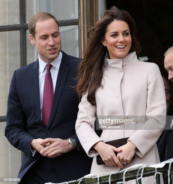 Catherine Duchess of Cambridge and Prince William Duke of Cambridge smile and wave to the crowds from the balcony of Cambridge Guildhall as they pay...