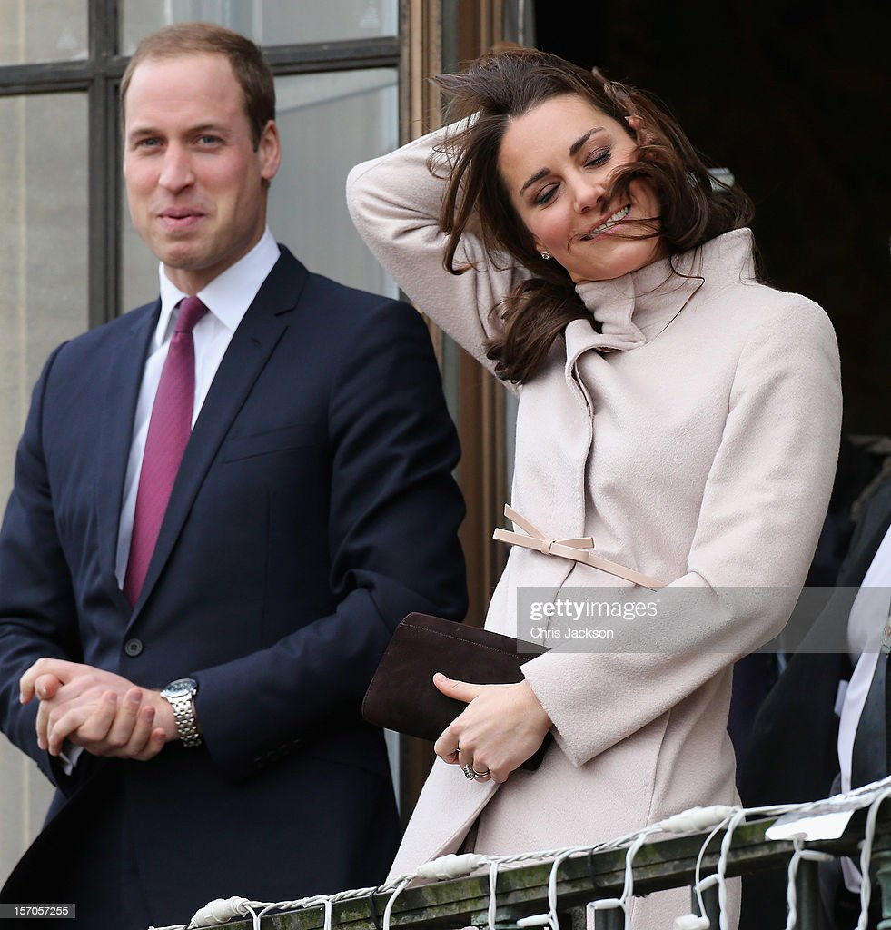 Catherine, Duchess of Cambridge and Prince William, Duke of Cambridge smile and wave to the crowds from the balcony of Cambridge Guildhall as they pay an official visit to Cambridge on November 28, 2012 in Cambridge, England.