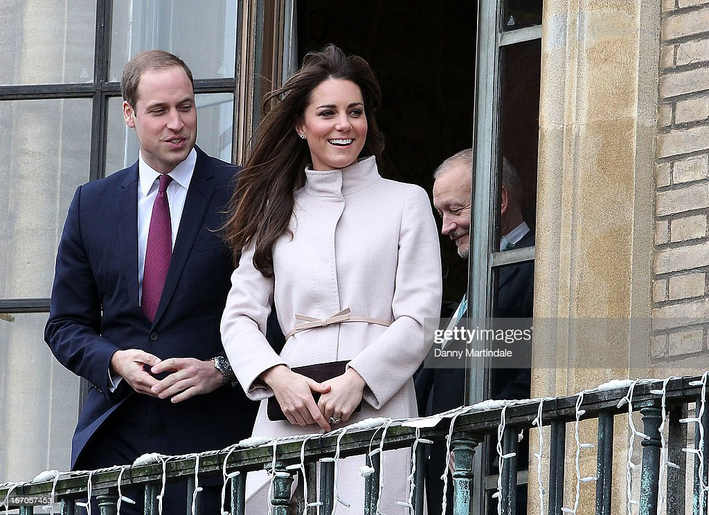 Catherine, Duchess of Cambridge and <a gi-track='captionPersonalityLinkClicked' href=/galleries/search?phrase=Prince+William&family=editorial&specificpeople=178205 ng-click='$event.stopPropagation()'>Prince William</a>, Duke of Cambridge smile and wave to the crowds from the balcony of Cambridge Guildhall as they pay an official visit to Cambridge on November 28, 2012 in Cambridge, England.