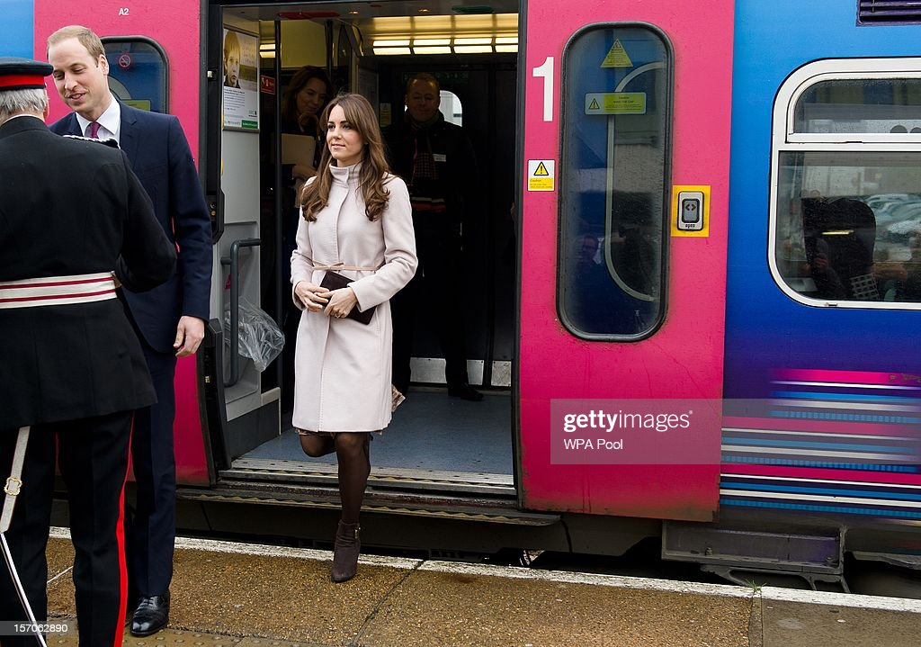 Catherine, Duchess of Cambridge and Prince William, Duke of Cambridge are greeted by the Lord Lieutenant of Cambridgeshire as they arrive at Cambridge station as they pay an official visit to Cambridge on November 28, 2012 in Cambridge, England.