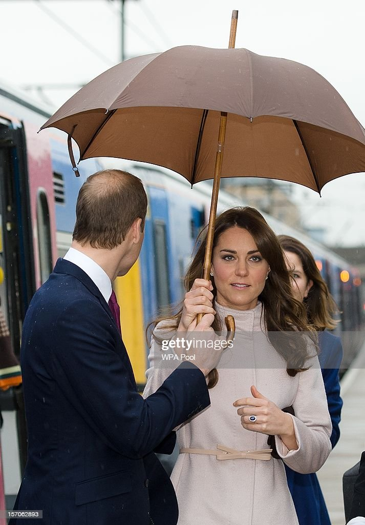 Catherine, Duchess of Cambridge and Prince William, Duke of Cambridge arrive at Cambridge station as they pay an official visit to Cambridge on November 28, 2012 in Cambridge, England.