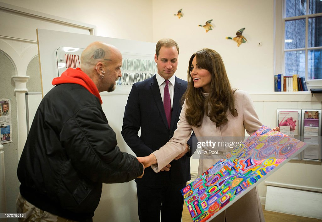 Catherine, Duchess of Cambridge and Prince William, Duke of Cambridge receive a painting from former shelter guest Twig during their visit at 'Jimmy's', a night shelter, on November 28, 2012 in Cambridge, England.