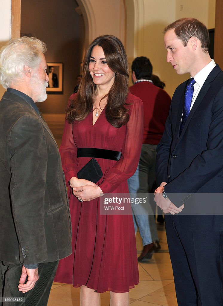 Catherine, Duchess of Cambridge and Prince William, Duke of Cambridge meet artist Paul Emsley after viewing his new portrait of the Duchess during a private viewing at the National Portrait Gallery on January 11, 2013 in London, England.
