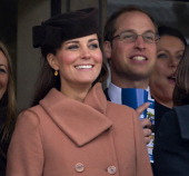 Catherine Duchess of Cambridge and Prince William Duke of Cambridge watch the racing as they attend Day 4 of The Cheltenham Festival at Cheltenham...