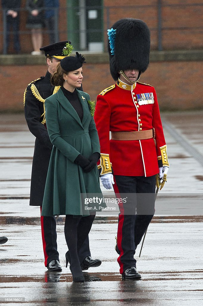 <a gi-track='captionPersonalityLinkClicked' href=/galleries/search?phrase=Catherine+-+Duchess+of+Cambridge&family=editorial&specificpeople=542588 ng-click='$event.stopPropagation()'>Catherine</a>, Duchess of Cambridge and <a gi-track='captionPersonalityLinkClicked' href=/galleries/search?phrase=Prince+William&family=editorial&specificpeople=178205 ng-click='$event.stopPropagation()'>Prince William</a>, Duke of Cambridge (Behind) attend a St Patrick's Day parade by the 1st Battalion Irish Guards as they visit Aldershot Barracks on St Patrick's Day on March 17, 2013 in Aldershot, England.