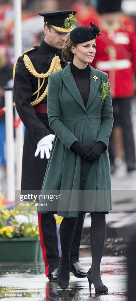 <a gi-track='captionPersonalityLinkClicked' href=/galleries/search?phrase=Catherine+-+Duchess+of+Cambridge&family=editorial&specificpeople=542588 ng-click='$event.stopPropagation()'>Catherine</a>, Duchess of Cambridge, and <a gi-track='captionPersonalityLinkClicked' href=/galleries/search?phrase=Prince+William&family=editorial&specificpeople=178205 ng-click='$event.stopPropagation()'>Prince William</a>, Duke of Cambridge attend The Irish Guards St Patricks Day Parade, at Mons Barracks, where The Duchess presented the traditional sprigs of shamrock, on March 17, 2013 in Aldershot, England.
