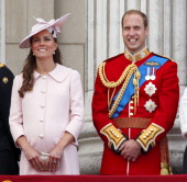 Catherine Duchess of Cambridge and Prince William Duke of Cambridge stand on the balcony of Buckingham Palace during the annual Trooping the Colour...