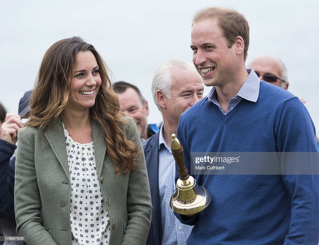 Catherine, Duchess of Cambridge and <a gi-track='captionPersonalityLinkClicked' href=/galleries/search?phrase=Prince+William&family=editorial&specificpeople=178205 ng-click='$event.stopPropagation()'>Prince William</a>, Duke of Cambridge start The Ring O'Fire Anglesey Coastal Ultra Marathon on August 30, 2013 in Holyhead, Wales.