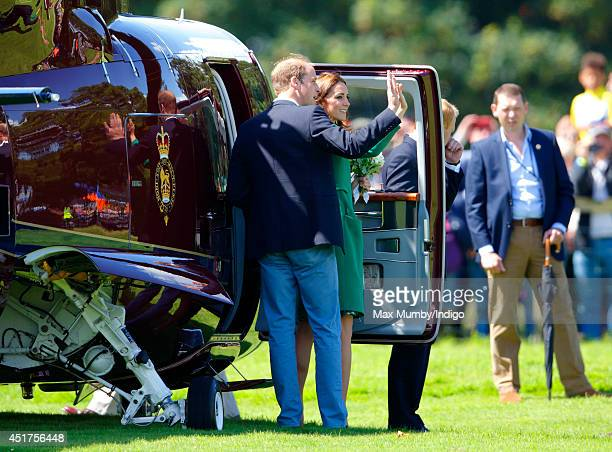 Catherine Duchess of Cambridge and Prince William Duke of Cambridge wave as they board a Sikorsky Helicopter as they leave Harewood House after...