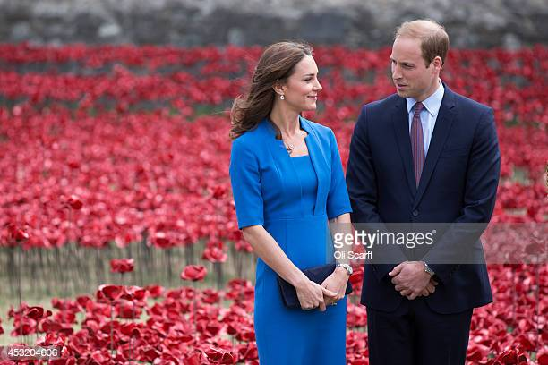 Catherine Duchess of Cambridge and Prince William Duke of Cambridge walk through an installation entitled 'Blood Swept Lands and Seas of Red' by...