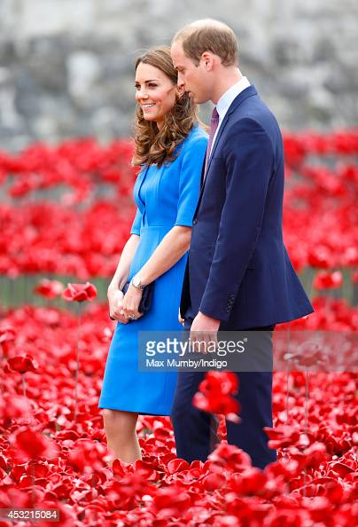 Catherine Duchess of Cambridge and Prince William Duke of Cambridge walk through a poppy field art installation entitled 'Blood Swept Lands and Seas...