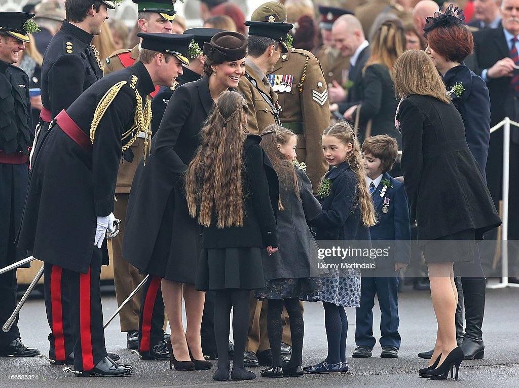 Catherine Duchess of Cambridge and Prince William Duke of Cambridge talks to some children during the St Patrick's Day Parade at Mons Barracks on...