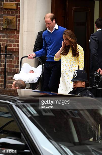 Catherine Duchess of Cambridge and Prince William Duke of Cambridge leave The Lindo Wing of St Mary's Hospital with their newborn daughter on May 2...
