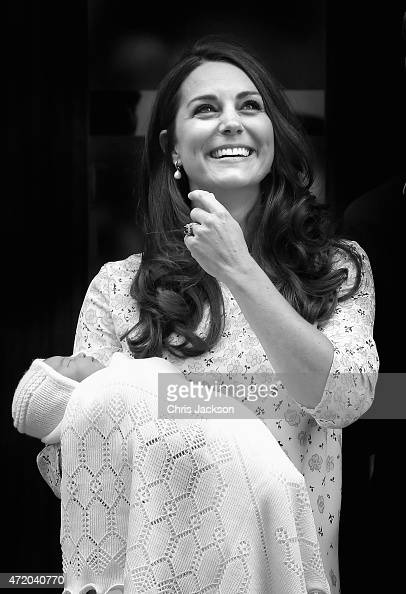 Catherine Duchess of Cambridge and Prince William Duke of Cambridge depart the Lindo Wing with their newborn daughter at St Mary's Hospital on May 2...