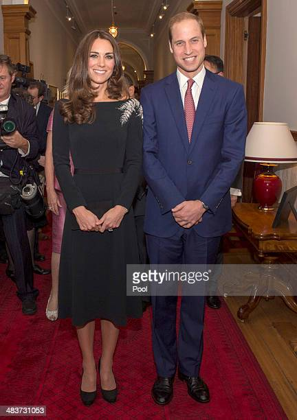 Catherine Duchess of Cambridge and Prince William Duke of Cambridge pose for a picture as they attend an art unveiling of a portrait of Queen...