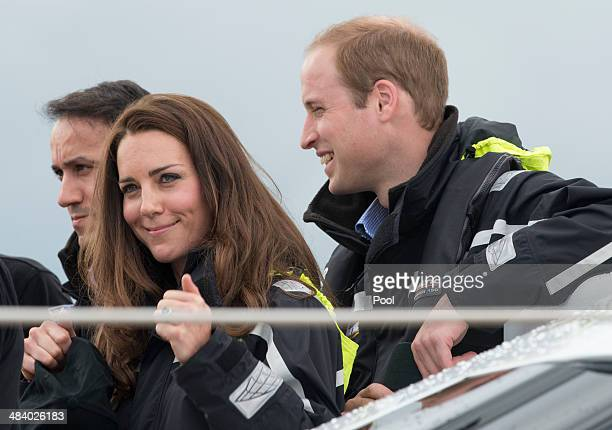 Catherine Duchess of Cambridge and Prince William Duke of Cambridge on board an America's Cup yacht in Auckland Harbour on April 11 2014 in Auckland...