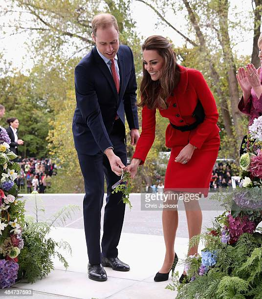 Catherine Duchess of Cambridge and Prince William Duke of Cambridge prepare to cut the 'flower ribbon' when they officially open the Visitor's Centre...