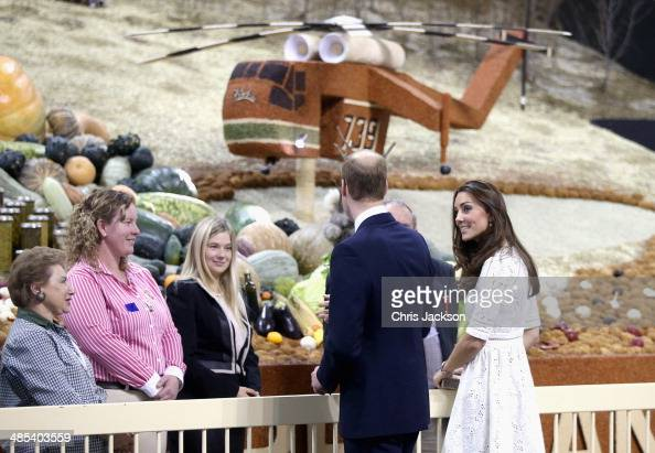 Catherine Duchess of Cambridge and Prince William Duke of Cambridge walk past a 'grain helicopter' on as they visit the Sydney Royal Easter Show on...