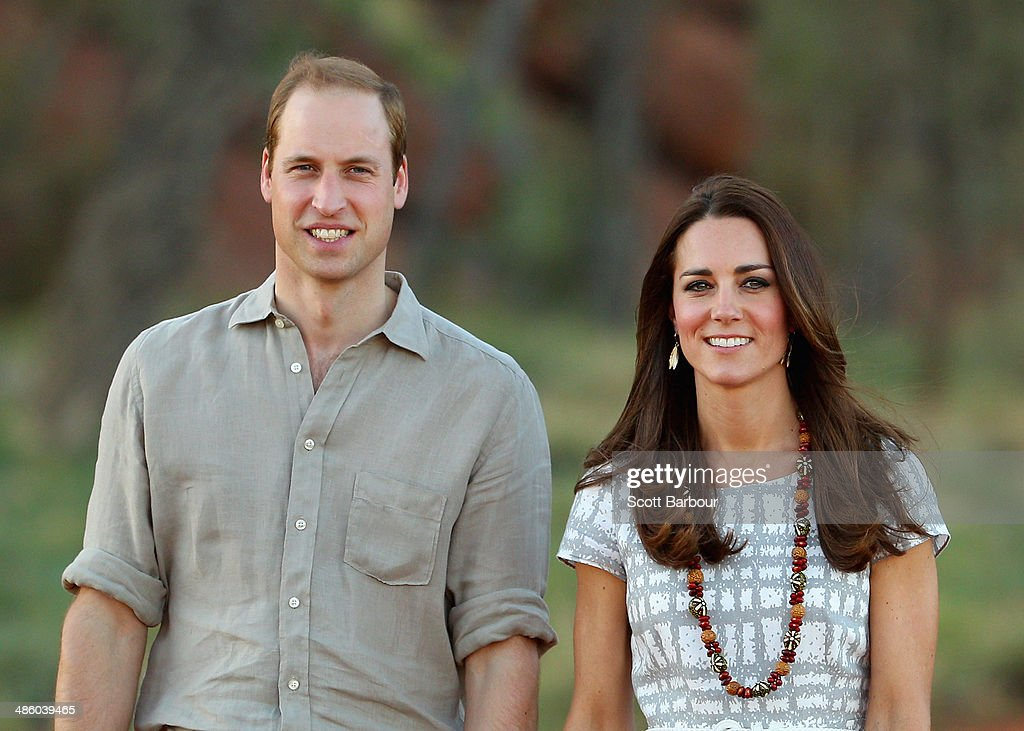 Catherine, Duchess of Cambridge and <a gi-track='captionPersonalityLinkClicked' href=/galleries/search?phrase=Prince+William&family=editorial&specificpeople=178205 ng-click='$event.stopPropagation()'>Prince William</a>, Duke of Cambridge walk down Kuniya Walk at the base of Uluru on April 22, 2014 in Ayers Rock, Australia. The Duke and Duchess of Cambridge are on a three-week tour of Australia and New Zealand, the first official trip overseas with their son, Prince George of Cambridge.