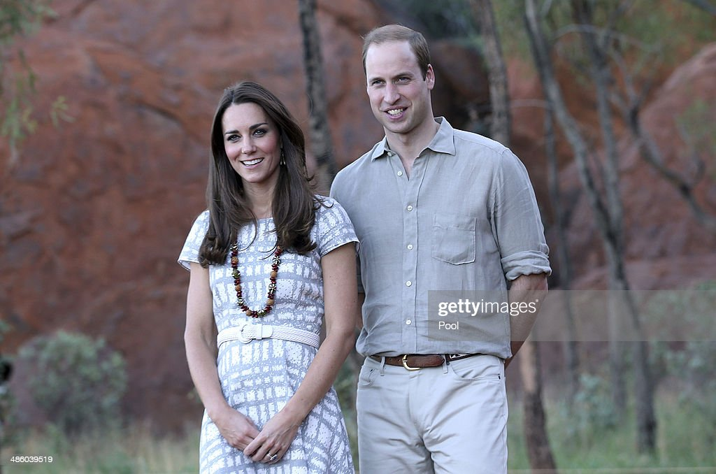 Catherine, Duchess of Cambridge and <a gi-track='captionPersonalityLinkClicked' href=/galleries/search?phrase=Prince+William&family=editorial&specificpeople=178205 ng-click='$event.stopPropagation()'>Prince William</a>, Duke of Cambridge pose for a photo on the Kuniya walk at Uluru on April 22, 2014 in Ayers Rock, Australia. The Duke and Duchess of Cambridge are on a three-week tour of Australia and New Zealand, the first official trip overseas with their son, Prince George of Cambridge.