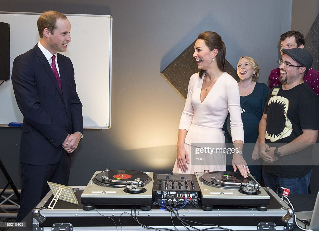 Catherine, Duchess of Cambridge and <a gi-track='captionPersonalityLinkClicked' href=/galleries/search?phrase=Prince+William&family=editorial&specificpeople=178205 ng-click='$event.stopPropagation()'>Prince William</a>, Duke of Cambridge laugh as they are shown how to play on DJ decks at the youth community centre, The Northern Sound System in Elizabeth on April 23, 2014 in Adelaide, Australia. The Duke and Duchess of Cambridge are on a three-week tour of Australia and New Zealand, the first official trip overseas with their son, Prince George of Cambridge.