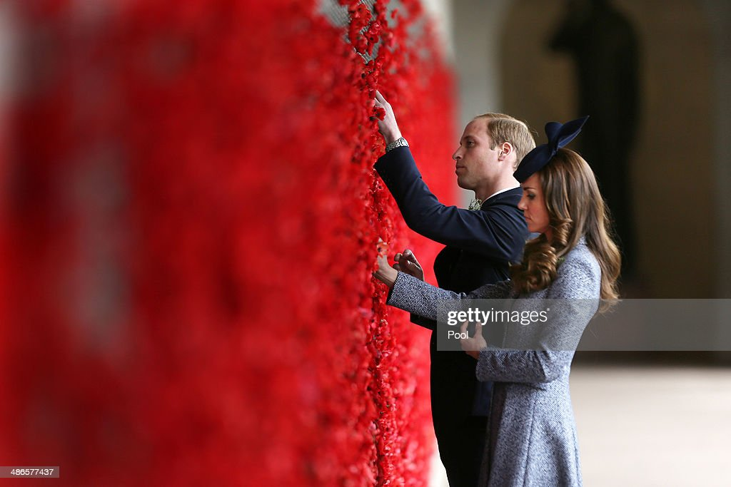 Catherine, Duchess of Cambridge and Prince William, Duke of Cambridge place a poppy flower into the World War I Wall of Remembrance during their visit to the Australian War Memorial on ANZAC Day on April 25 2014 in Canberra, Australia. The Duke and Duchess of Cambridge are on a three-week tour of Australia and New Zealand, the first official trip overseas with their son, Prince George of Cambridge.