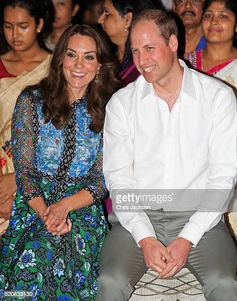 Catherine Duchess of Cambridge and Prince William Duke of Cambridge watch dancing by the fireside during a Bihu Festival Celebration at Diphlu River...