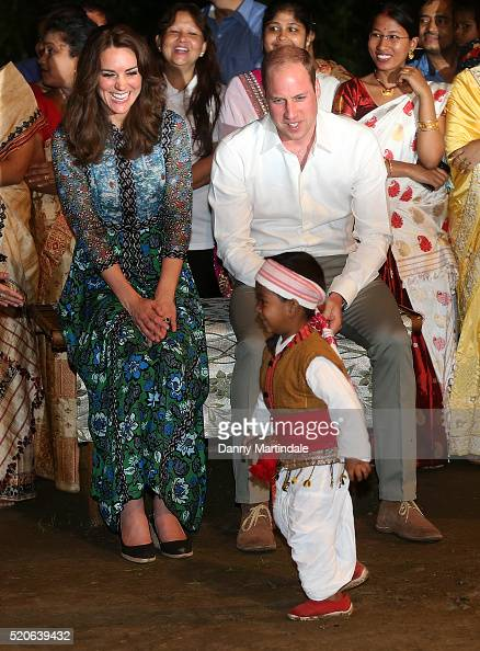Catherine Duchess of Cambridge and Prince William Duke of Cambridge meet a young dancer as they watch dancing by the fireside during a Bihu Festival...