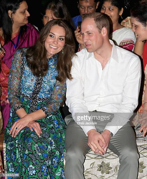 Catherine Duchess of Cambridge and Prince William Duke of Cambridge watch dancing by the fireside during a Bihu Festival Celebrationat Diphlu River...