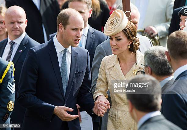 Catherine Duchess of Cambridge and Prince William Duke of Cambridge hold hands as they attend the Secretary of State's annual Garden party at...