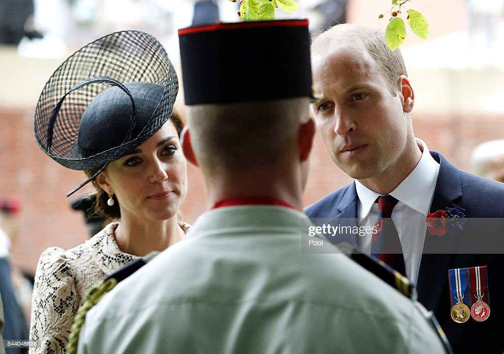 Catherine, Duchess of Cambridge and <a gi-track='captionPersonalityLinkClicked' href=/galleries/search?phrase=Prince+William&family=editorial&specificpeople=178205 ng-click='$event.stopPropagation()'>Prince William</a>, Duke of Cambridge chat with a soldier during the 100th anniversary of the beginning of the Battle of the Somme at the Thiepval memorial to the Missing on July 1, 2016 in Thiepval, France. The event is part of the Commemoration of the Centenary of the Battle of the Somme at the Commonwealth War Graves Commission Thiepval Memorial in Thiepval, France, where 70,000 British and Commonwealth soldiers with no known grave are commemorated.