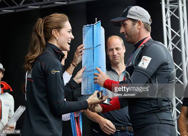 Catherine Duchess of Cambridge and Prince William Duke of Cambridge present Sir Ben Ainslie with the America's Cup 2016 trophy on stage at the...