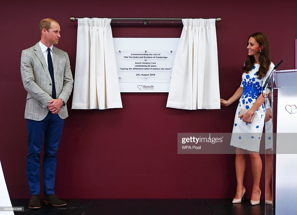 Catherine Duchess of Cambridge and Prince William Duke of Cambridge unveil a plaque for the hospice's 25th anniversary during their visit to Keech...
