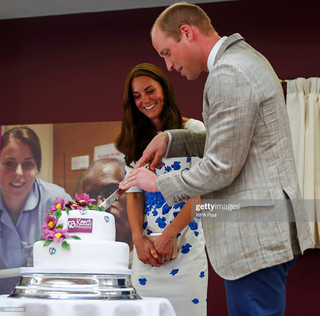 Catherine Duchess of Cambridge and Prince William Duke of Cambridge cut a 25th anniversary cake during their visit to Keech Hospice Care on August 24...